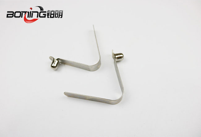 Solid single button spring clip